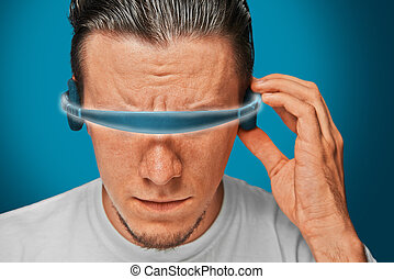 Man in hi-tech glasses - Serious man in cyber glasses,...