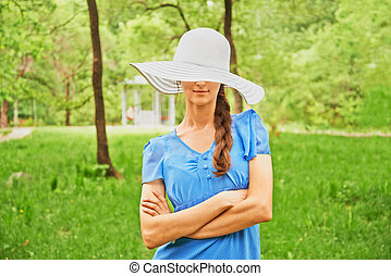 Young woman in fashionable hat