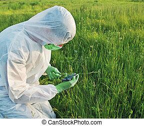 Scientist working on field - Scientist in biohazard uniform...