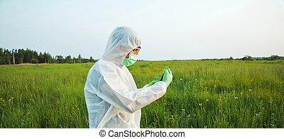 Scientist on summer field - Biotechnology scientist in...
