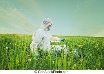Scientist outdoor - Scientist man in biohazard uniform sits...