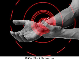 Pain wrist - Acute pain in a male wrist. Man holds his hand,...