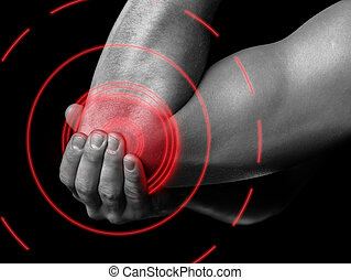 Pain elbow of red color - Man is touching his elbow due to...