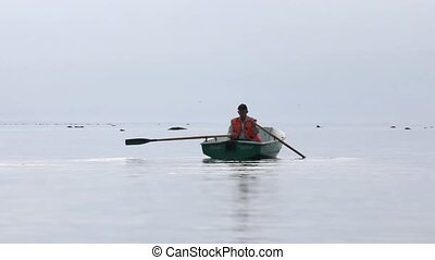 Rowing boat on the horizon