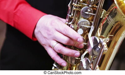 Play on saxophone - Men's fingers playing on saxophone