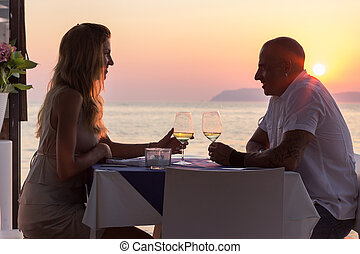 Couple on romantic dinner - Couple dining in sea restaurant...