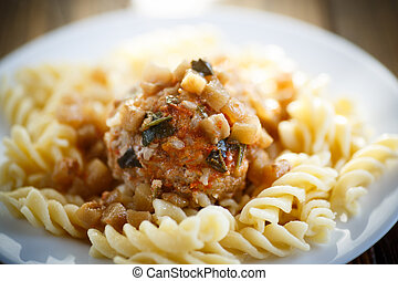 meatballs with sauce and noodles on a wooden table