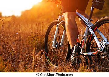 cyclist man legs riding mountain bike outdoor - Closeup of...