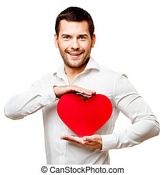 Young man carries heart shaped red card isolated on white
