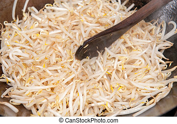 Beansprouts in wok - Beansprouts in a hot wok being fried