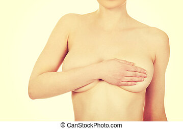Topless woman covers her breast. - Beautiful topless woman...
