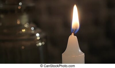 macro shot of a white candle - blowing out a candle, close...