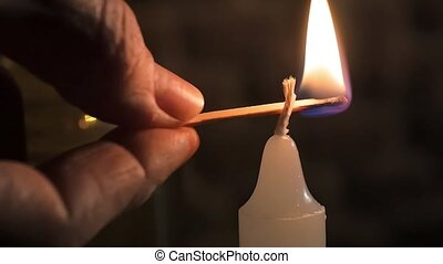 macro shot of a white candle - lighting up a wight candle,...