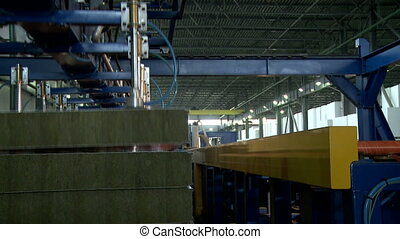 Finished sandwich panels removed from conveyor - View of...