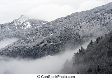 Mountainvalley - Mountain valley with snow and low clouds