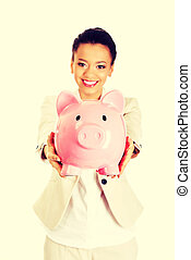 Business woman with a piggybank. - African business woman...