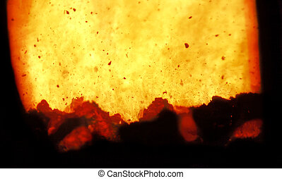 Fire and combustion - Fire and burning coal in a combustion...