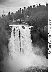 Powerful Snoqualmie Falls BW - A heavy mist rises as...