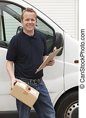 Courier Delivering Package Standing Next To Van