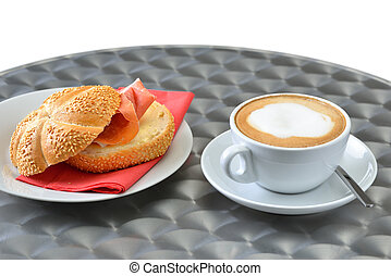 Coffee break with a cup of cappuccino and a ham sandwich