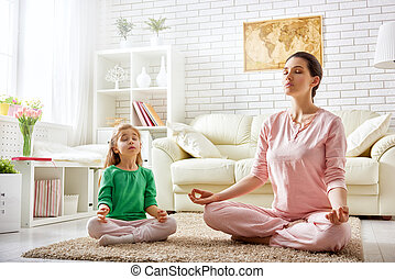 woman practice yoga - beautiful girl is engaged in yoga with...