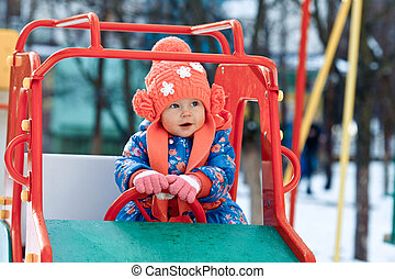 The little girl is taken for a ride in a car in children's...