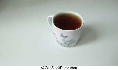 Women's cup of tea - women's cup of tea on the table