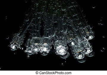 LEDs with gas bubbles are dipped in mineral water