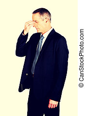 Businessman suffering from sinus pain - Mature businessman...