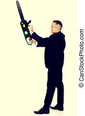 Angry businessman with chainsaw - Furious mature businessman...