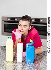 Unhappy single woman doing housework - Picture of unhappy...