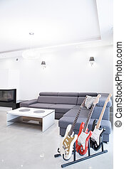 Electric guitars in living room - Three electric guitars in...