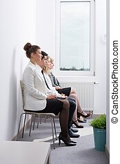 Candidates waiting for job interview - Image of candidates...