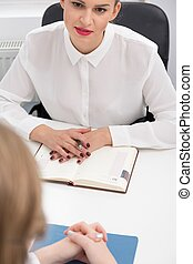 Co-worker during meeting - Image of female co-worker during...