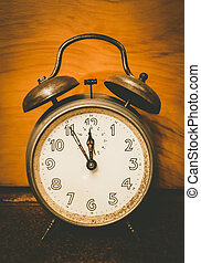 Eleven fifty-five clock - An old nostalgic alarm on a table