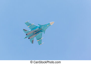 Russian fighter demonstration flight on blue sky background
