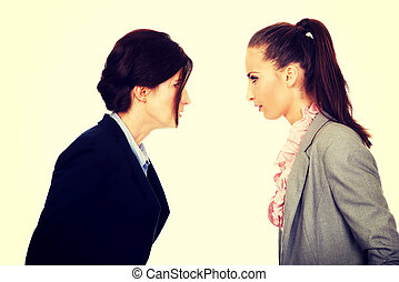 Two angry businesswomans face to face. - Two angry...