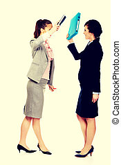 Angry businesswomen fighting with their binders - Angry...