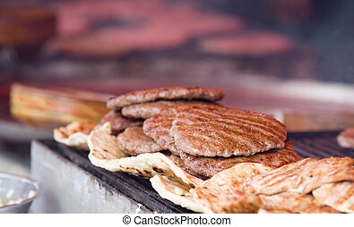 Balkan burgers - Close up of hot fat burgers prepared on...