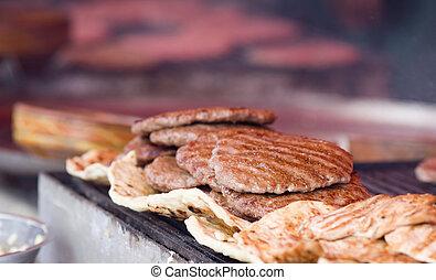 Balkan burgers - Close up of hot fat burgers prepared on...