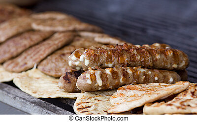 Balkan barbecue - Close up of hot cevaps, burgers and...