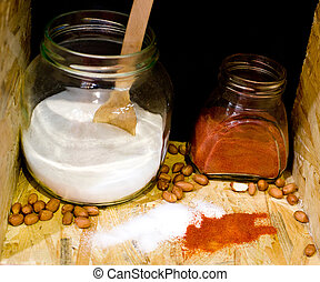 Salt and cayenne pepper in jars - Close up of two jars with...