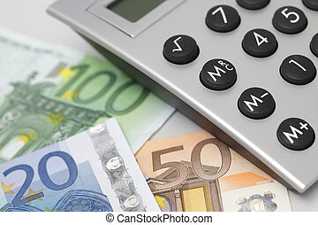 desktop calculator with money - desktop calculator, closeup...
