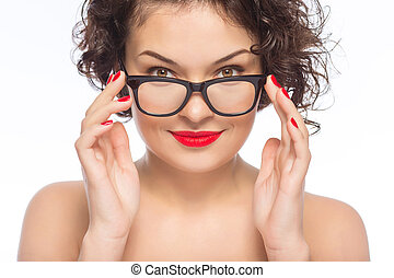 Young attractive woman posing with glasses.