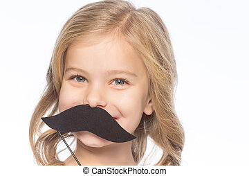 Little girl with decorative moustache - Girl with paper...