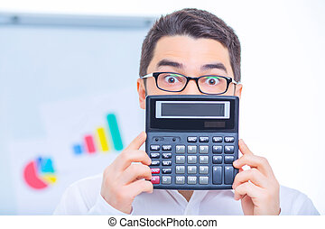 Young businessman upholding a calculator. - Funny moments....