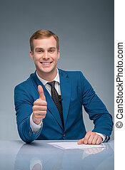 Smiling newscaster showing thumbs up - Positive man Handsome...