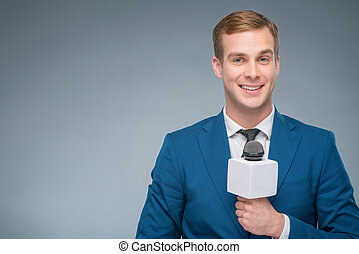 Smiling newsman holding a microphone - Smiling reporter...