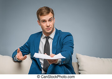 Handsome man upholding official papers. - Businessman with...