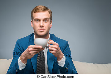 Attractive man with cup of tea - Tea time Handsome young...